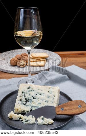 Cheese And Wine Pairing, French Soft Blue Roquefort Cheese And Sweet White Sauternes Wine From Borde