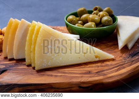 Spanish Snacks Tapas, Variety Of Sliced Goat, Sheep, Manchego Cheeses, Green Olives, Served In Andal