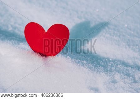 Lonely Valentine. Red Heart In Cold, Frosty Morning Snow. Valentines Day Greeting Card. A Symbol Of
