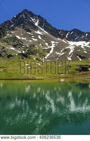 Passo Gavia, Sondrio Province, Lombardy, Italy: Landscape Along The Mountain Pass At Summer. Lake