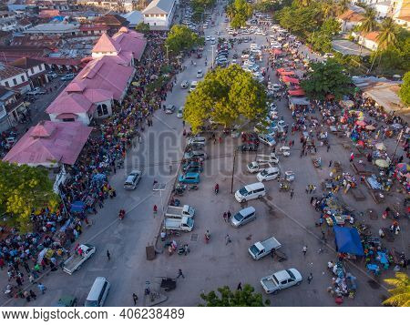 Aerial Shot Of Crowded City Market In Stone Town, The Capital Of Zanzibar, Tanzania. Active Trade On