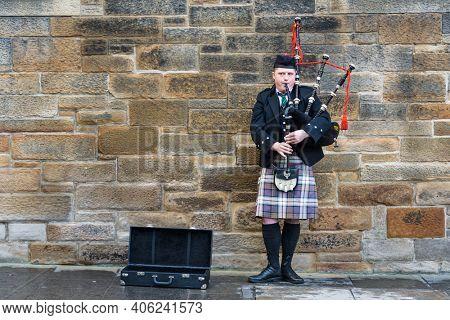 EDINBURGH, SCTOLAND - CIRCA NOVEMBER 2012: Man playing bagpipes in the street.