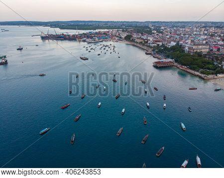 Aerial. Stone Town, Zanzibar, Tanzania. Flock Of Show Ships Near The Zanzibar Coastline In Stone Tow