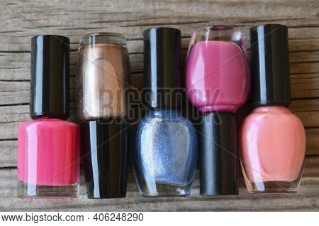 Colorful, Bright And Glittery Nail Polish Bottles On A Wooden Background.manicure Tools, Beauty, Nai