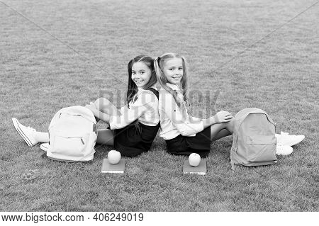Friends Makes You Happy. School Friends Relax On Green Grass. Happy Friends Back To School. Classmat