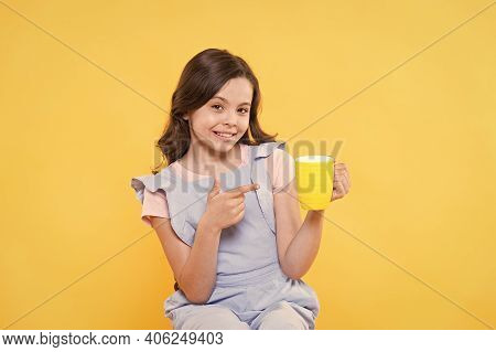 No Use Crying Over Spilt Milk. Drink Enough Water. Girl Kid Hold Mug Yellow Background. Carefree Smi