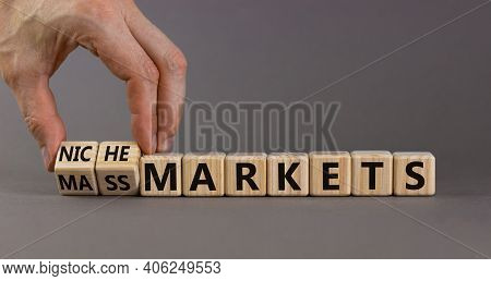 Mass Or Niche Markets Symbol. Businessman Turns Wooden Cubes And Changed Words 'mass Markets' To 'ni