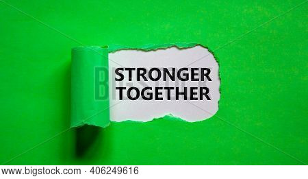 Stronger Together Symbol. Words Stronger Together Appearing Behind Torn Green Paper. Business, Motiv