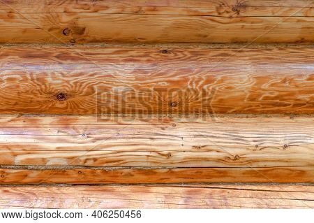 Beautiful Wood Structure Of Logs With Hemp Outside Wall. Rural Wood Horizontal Round Tree Trunks Of