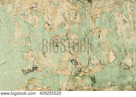 Destroyed Peeling Faded Paint Texture Background. Old Urban Cracked Painted Green Surface. Distresse