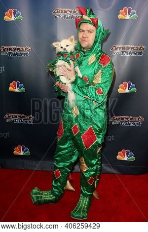 NEW YORK-SEP 16: Magician Piff the Magic Dragon (R) and Mr. Piffles attend the America's Got Talent Season 10 Finale taping at Radio City Music Hall on on September 16, 2015 in New York City.