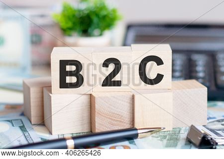 Dollars Banknote With Calculator And Word B2c. Banknotes And Wooden Cubes With Letters. Concept With