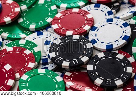 Poker Chips Close Up Background. Casino Concept, Risk, Chance, Good Luck Or Gambling. Detail Of Casi