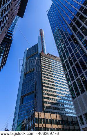 High-rise Buildings Viewed From Below. Blue Window Facade Of Commercial Buildings In Frankfurt Main.