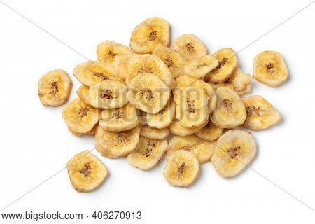 Heap of dried sweet banana chips close up isolated on white background