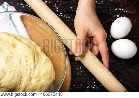 Rolling Pin For Rolling The Dough In Female Hands. Cooking Yeast Dough. Dough For Baking Bread In A