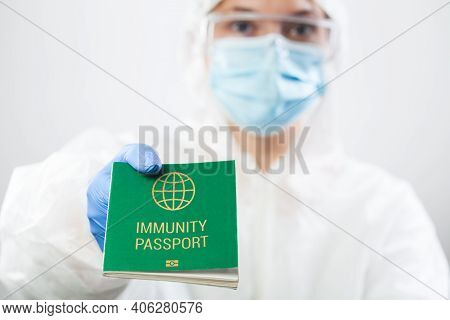 Medical Uk Healthcare Security Officer Worker In Personal Protective Equipment Holding Green Immunit