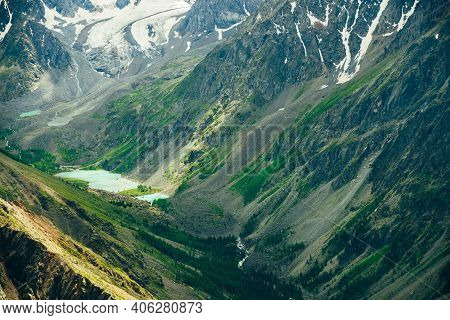 Aerial Spectacular View To Scenic Valley With Beautiful Mountain Lakes, Meltwater And Snowy Rocky Mo