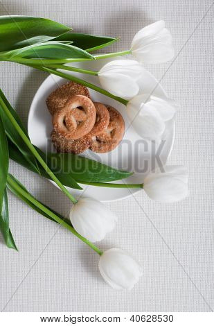 White Tulip Flowers and Pastry