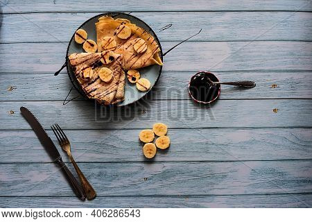 Flat Homemade Delicious Pancakes Whit Banana Slices And Chocolate Syrup/ European Flat Pancakes Serv
