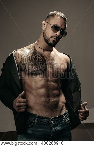 Man Fashion Undress. Bearded Male With Abs And Sunglasses. Trend Style Macho In Casual Style Clothes