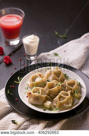 Manti Or Manty Dumplings In A Traditional Bowl On Wooden Table
