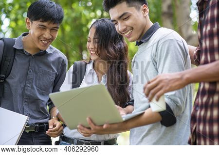Group Of Diversity Student Working On Laptop And Smart Phone Together At University, Happy Multi Eth
