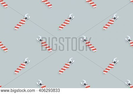Adjustable Wrench Seamless Pattern. Background Made Of A Metal Adjustable Wrench With A Rubber Strip