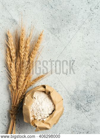 Wheat Flour In Paper Bag And Spikes Over Gray Cement Background. Food And Baking Ingredient - All-pu