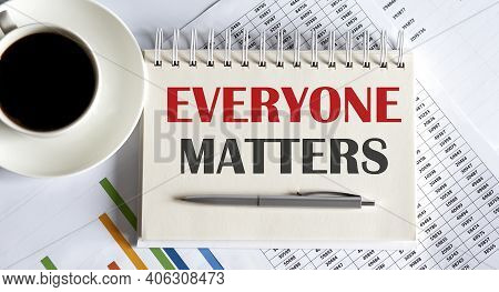 Everyone Matters Text Written On Notebook With Pen And Chart
