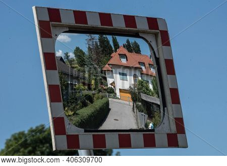 Single Family Detached Home Building In A Mirror