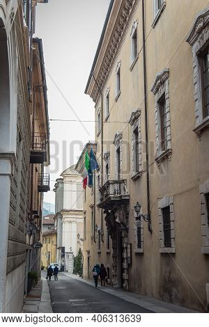 Brescia, Italy - December, 2015: Beautiful Narrow Alley With Many Windows In Brescia City. Historica