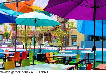 February 2, 2021 In Palm Springs, Ca:  Colorful Umbrellas Over Tables And Chairs On An Outdoor Patio