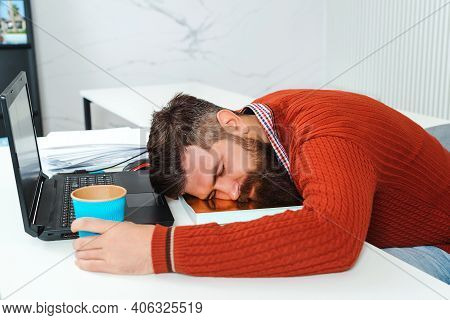 Tired Businessman Sleeping In Office. Bearded Man Sleeping At His Working Place. Young Business Man