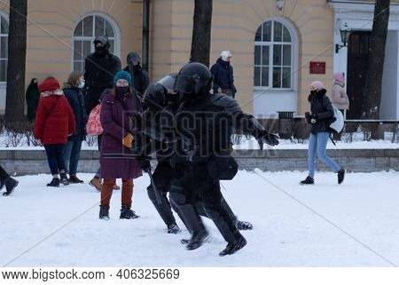 Saint Petersburg, Russia - 31 January 2021: The Police Run After The Man To Be Arrested At The Prote