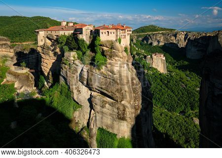 Monastery of Varlaam monastery and Monastery of Rousanou in famous greek tourist destination Meteora in Greece on sunset with scenic scenery landscape
