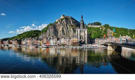 Picturesque Dinant town, Dinant Citadel and Collegiate Church of Notre Dame de Dinant and Pont Charles de Gaulle bridge over Meuse river. Belgian province of Namur, Blegium
