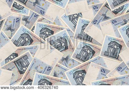 10 Tunisian Dinars Bills Lies In Big Pile. Rich Life Conceptual Background. Big Amount Of Money