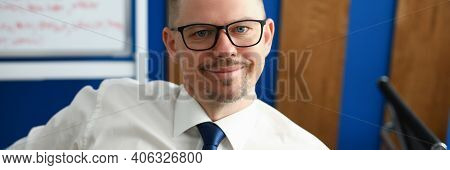Portrait Of Middle-aged Man Wearing Posh Suit And Using Mobile Phone. Male Person Search Information