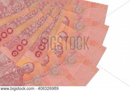 100 Thai Baht Bills Lies Isolated On White Background With Copy Space Stacked In Fan Shape Close Up.