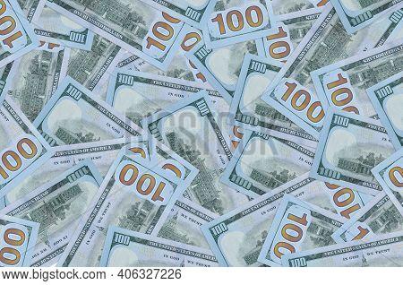 100 Us Dollars Bills Lies In Big Pile. Rich Life Conceptual Background. Big Amount Of Money