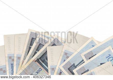 10 Tunisian Dinars Bills Lies On Bottom Side Of Screen Isolated On White Background With Copy Space.