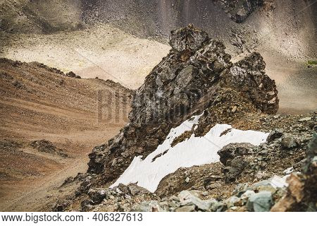 Atmospheric Alpine Landscape With Firn Or Snow Near Stony Cliff Close-up On Mountain Wall Background