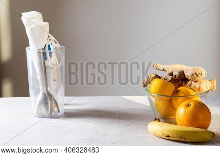 Blender And Fruits On The Table. White Blender In The Kitchen. Front View.