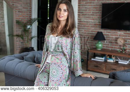 Beautiful Brunette Smiling Girl With Long Hair In Silk Trouser Suit With Pastel Multicolor Paisley P