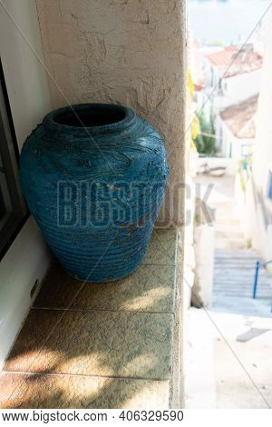 Vase On Brick Wall Blue Collor. Vase On Brick Wall With No Flowers In It. Romantic Picture Blue Vase