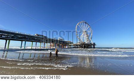Scheveningen, The Hague, The Netherlands, 22 January 2021: Famous Pier From Scheveningen Strand, Den