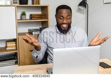 Confused And Surprised Young African-american Businessman Received Unexpected News, Sitting At The D