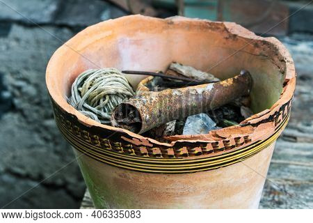 Old Plant Pot With Other Stuff Dumped In.