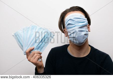 Man Getting Rich From Face Masks With Two Face Masks On Face.